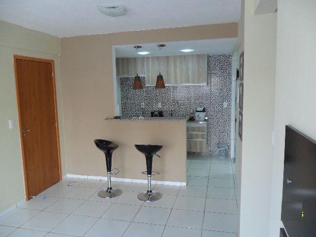 4 de 15: Sala vista para a cozinha tipo americana
