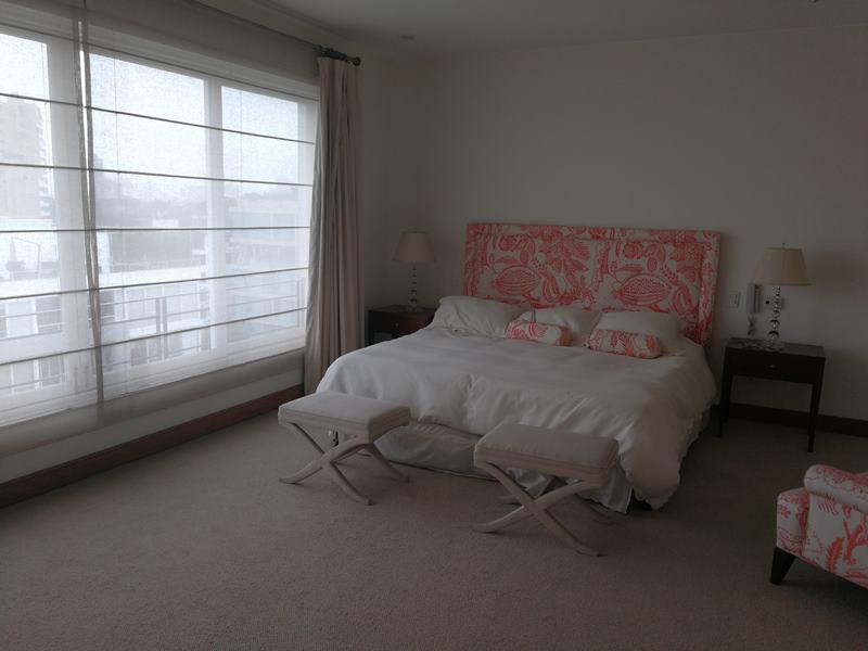 32 de 49: Dormitorio secundario con baño incorporado