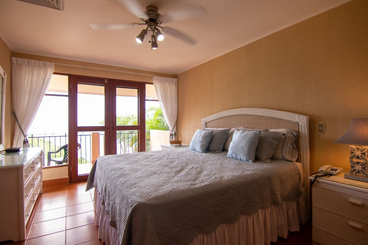 12 of 20: Master bedroom with ocean view and balcony