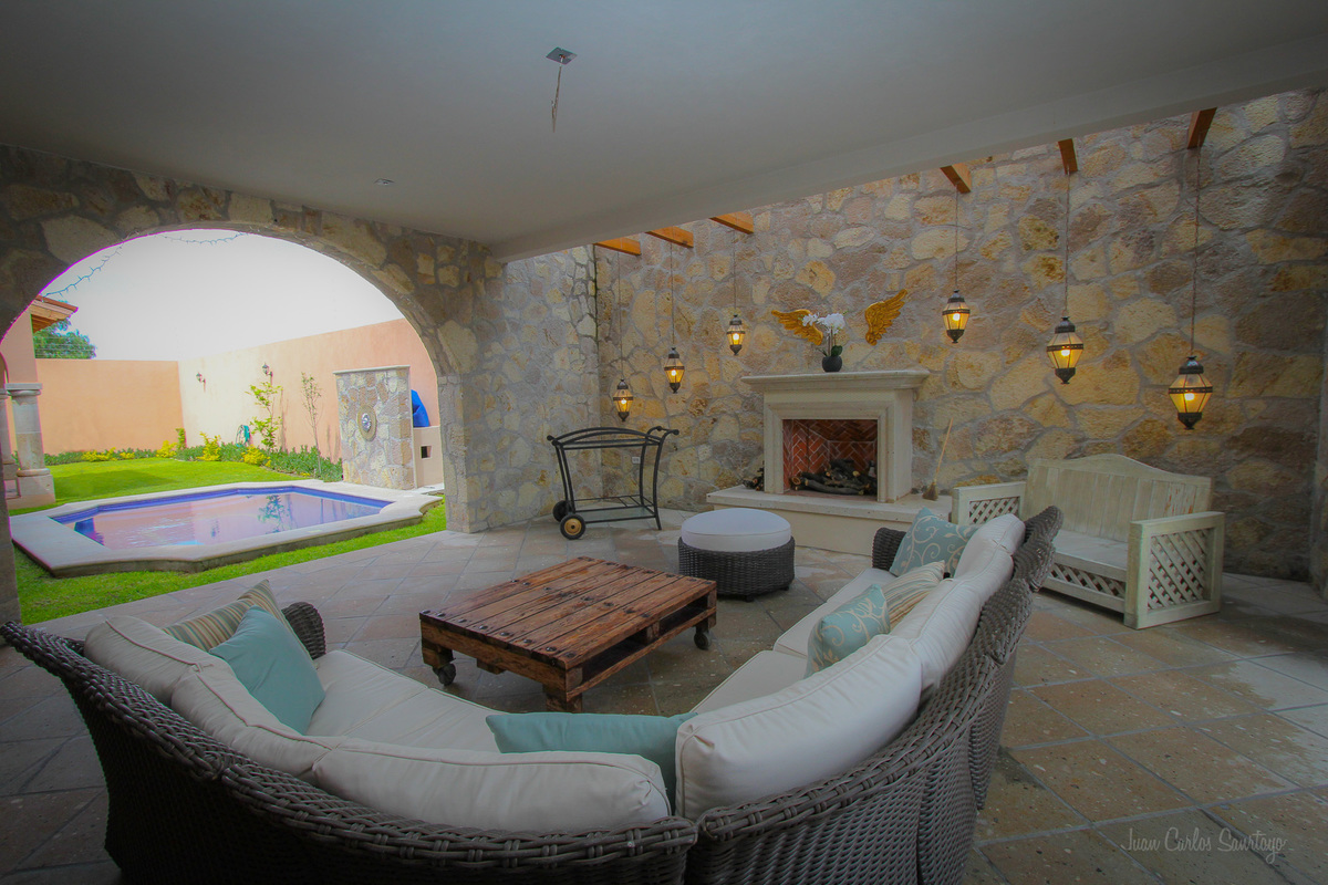 1 of 26: Out door covered patio with view of pool
