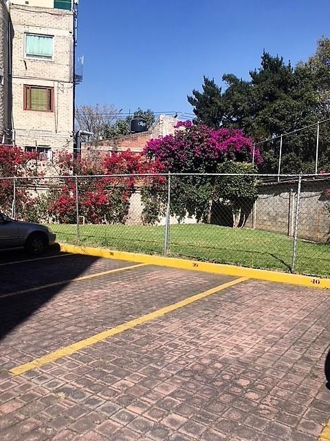 15 de 15: Estacionamiento