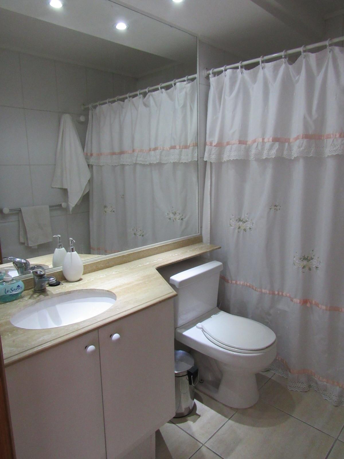 8 de 16: Baño en suite