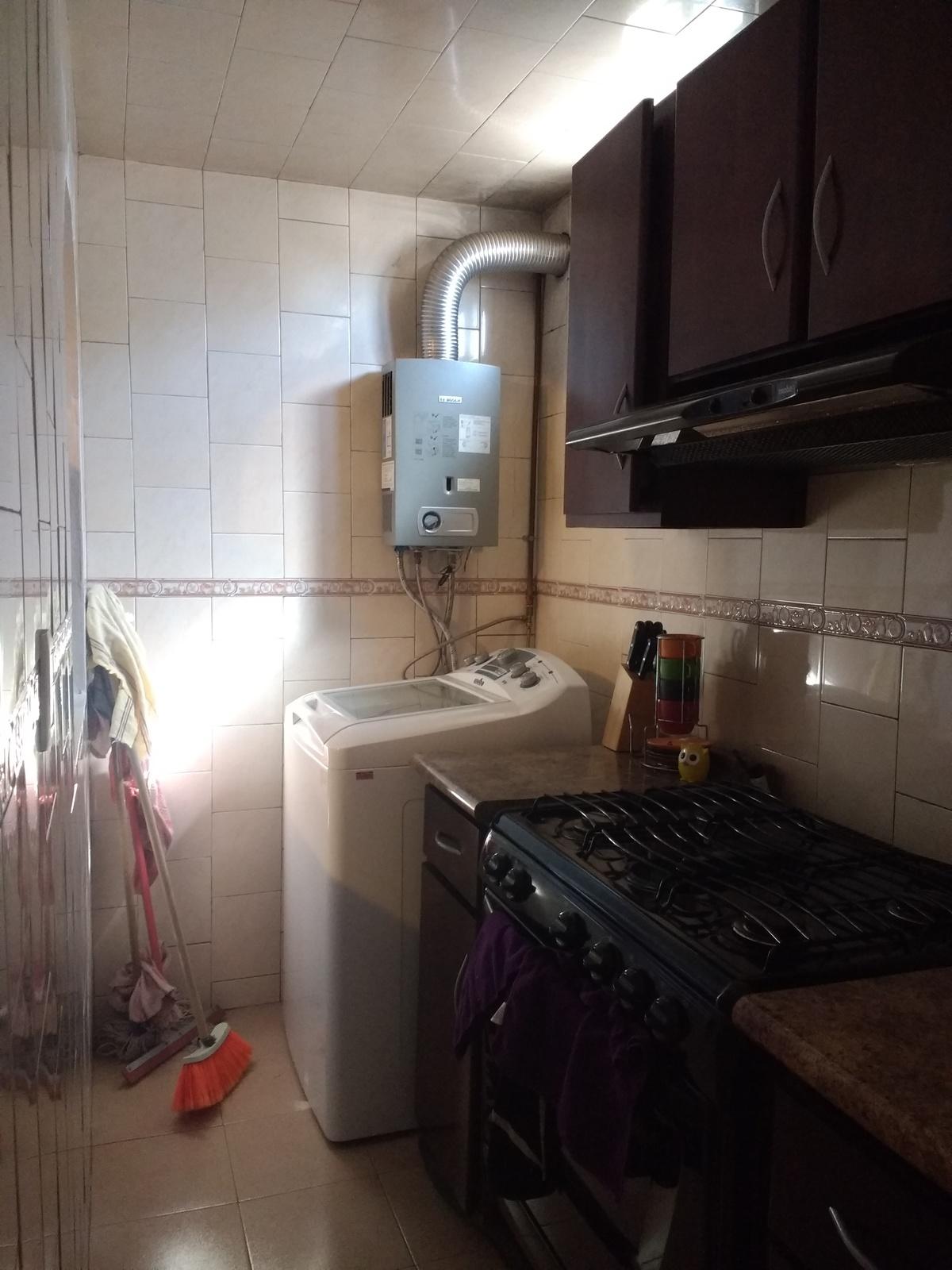 5 de 12: Ampliación para cocina.  con azulejo de primera. Calentador