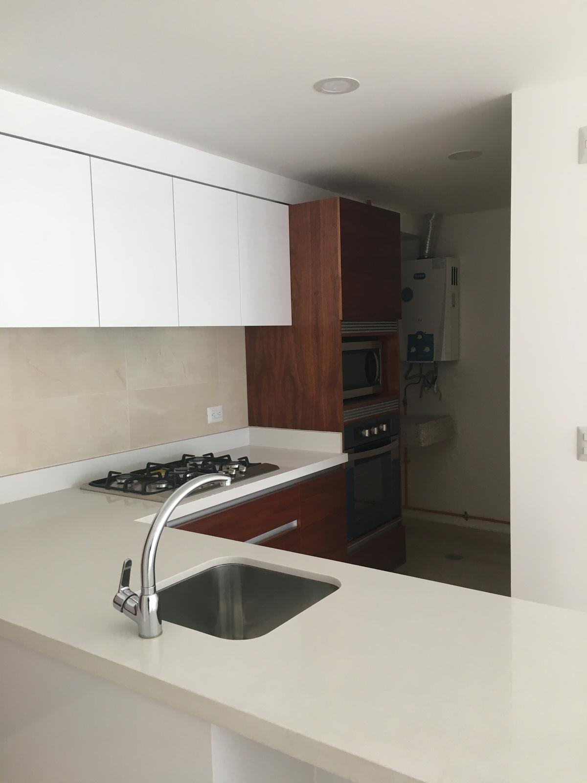 4 de 18: Cocina y área de lavado