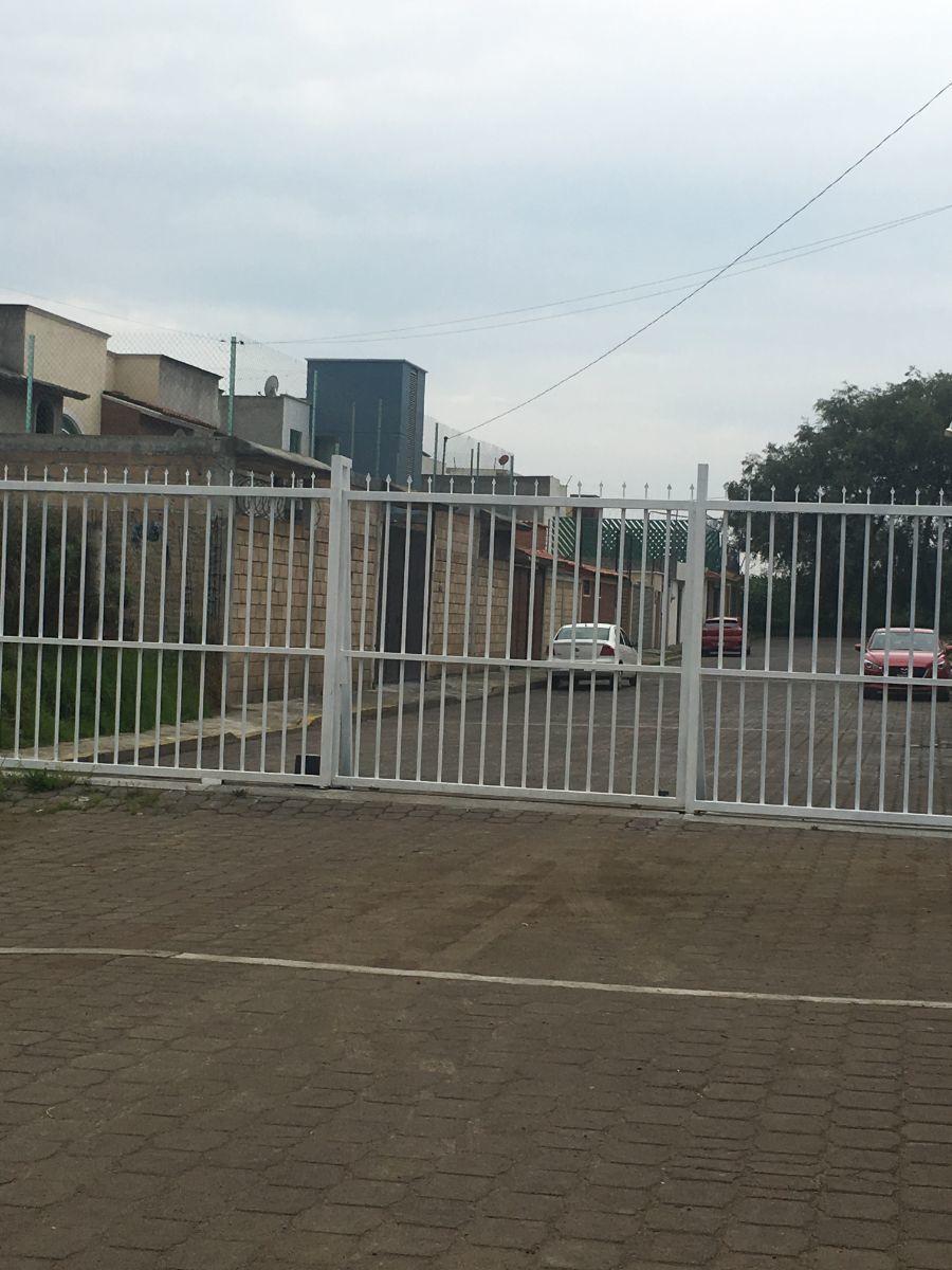 14 de 15: Portón eléctrico de la privada