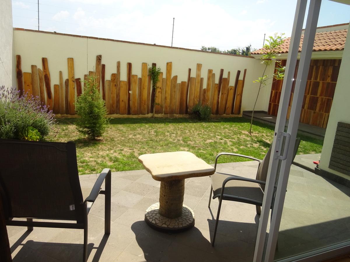 5 de 18: Jardín con terraza