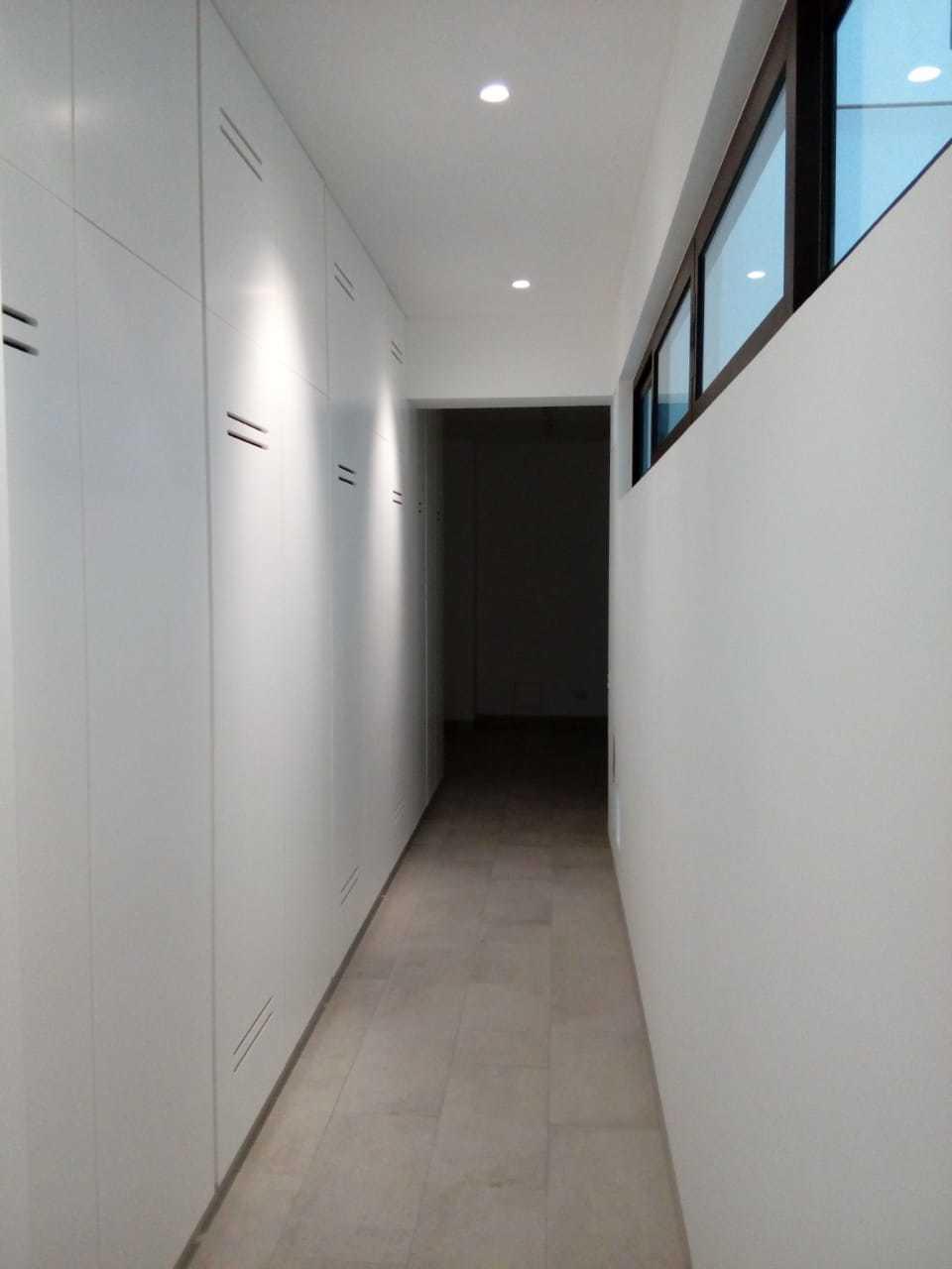 20 de 31: Clossets de pared a pared en zona de lavandería
