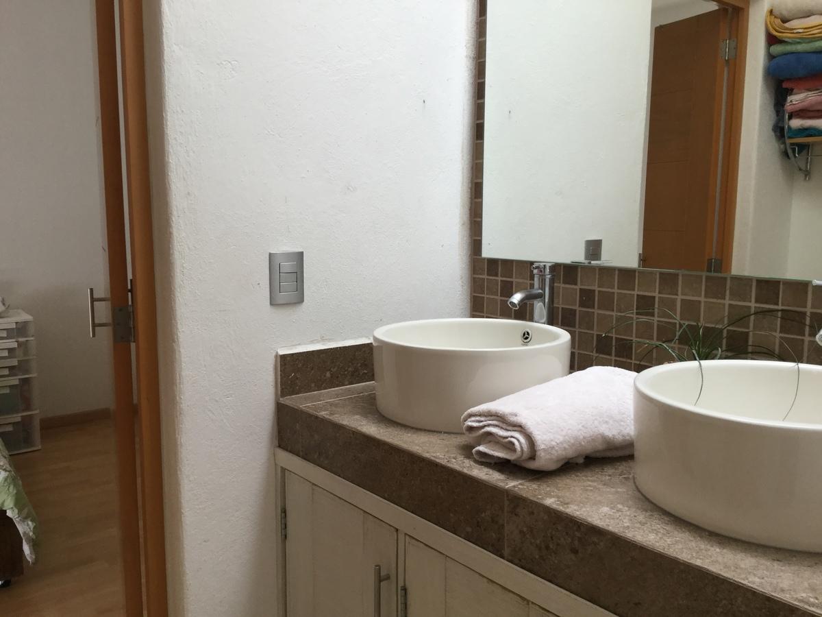 9 de 12: Baño compartido para dos recámaras