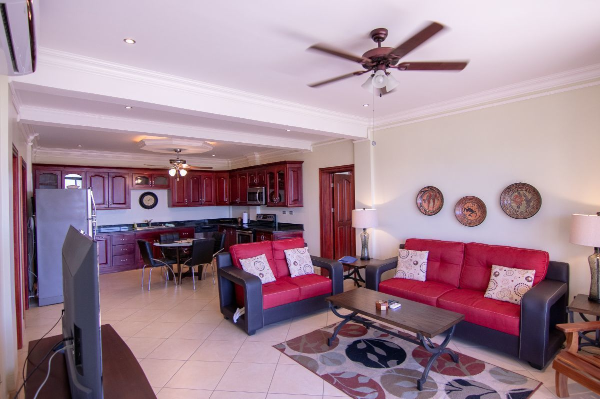 1 of 15: Ocean view living room and spacious kitchen