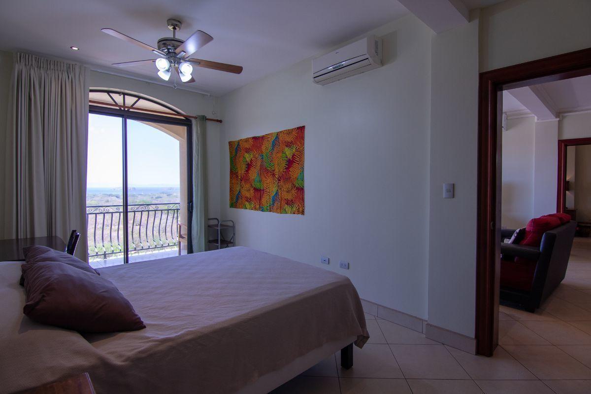 8 of 15: Ocean view master bedroom