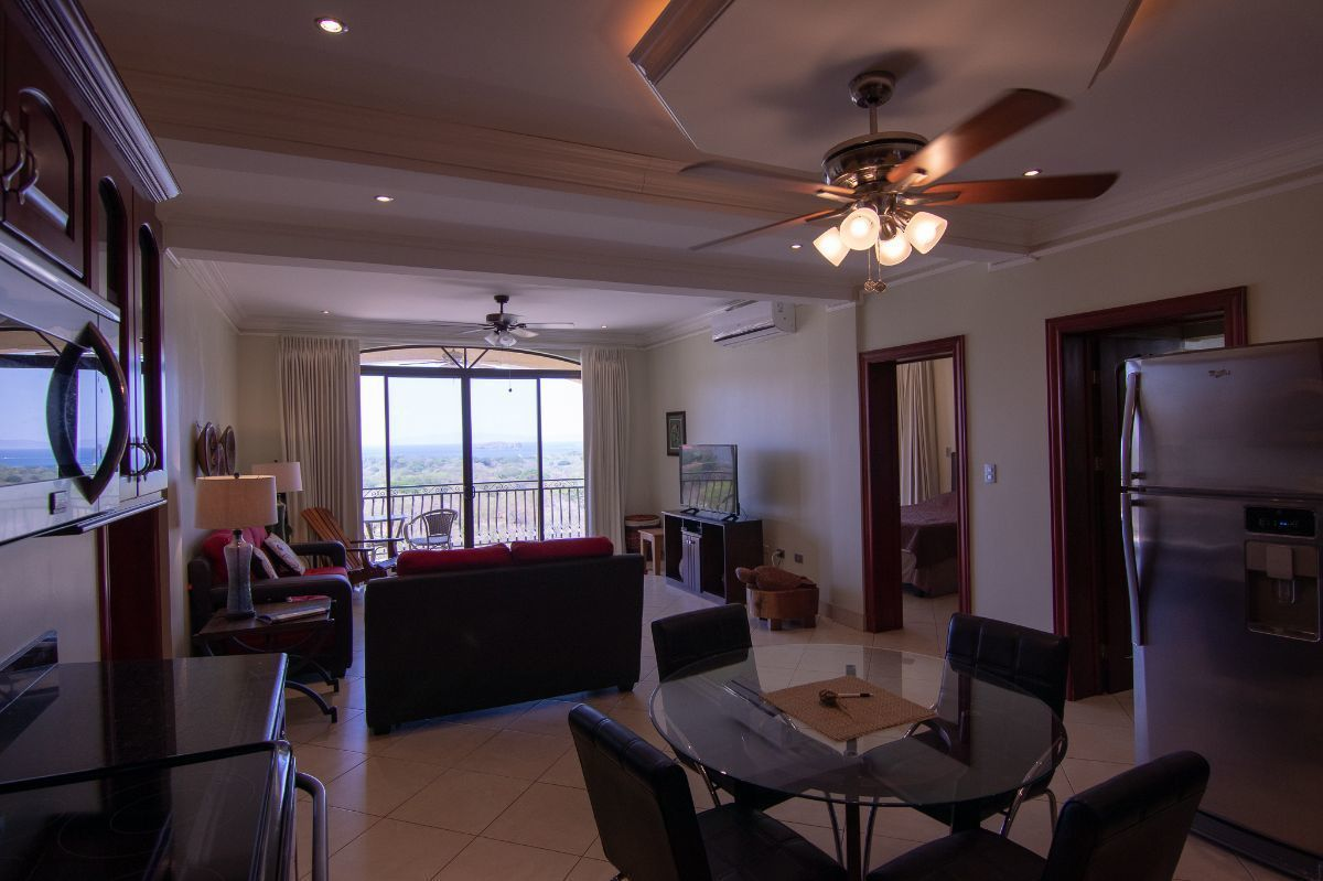 3 of 15: Ocean view living room and spacious kitchen