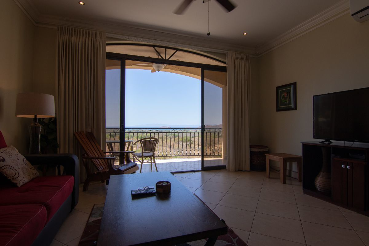 4 of 15: Ocean view living room and spacious kitchen