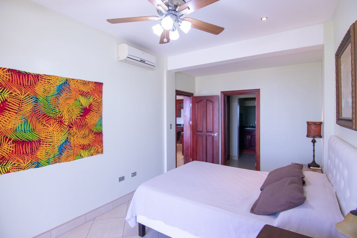9 of 15: Ocean view master bedroom