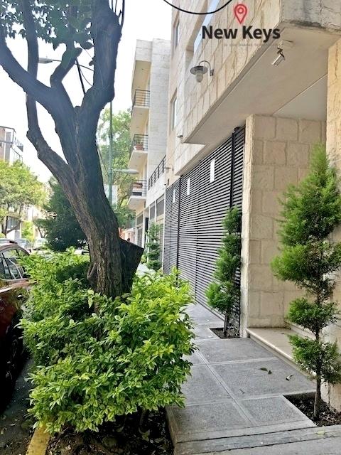 27 de 27: Vista a la Calle