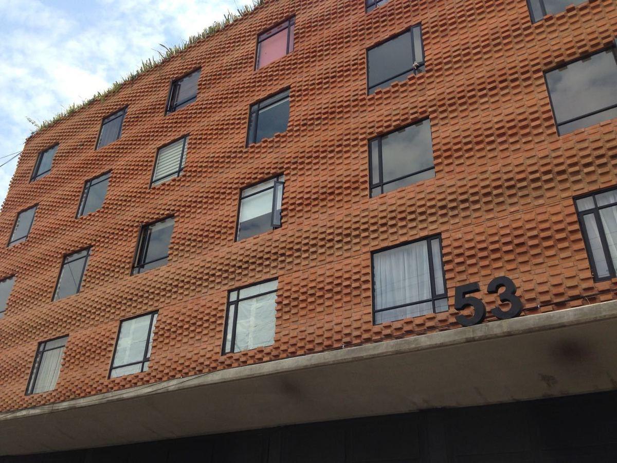 1 de 21: Fachada edificio