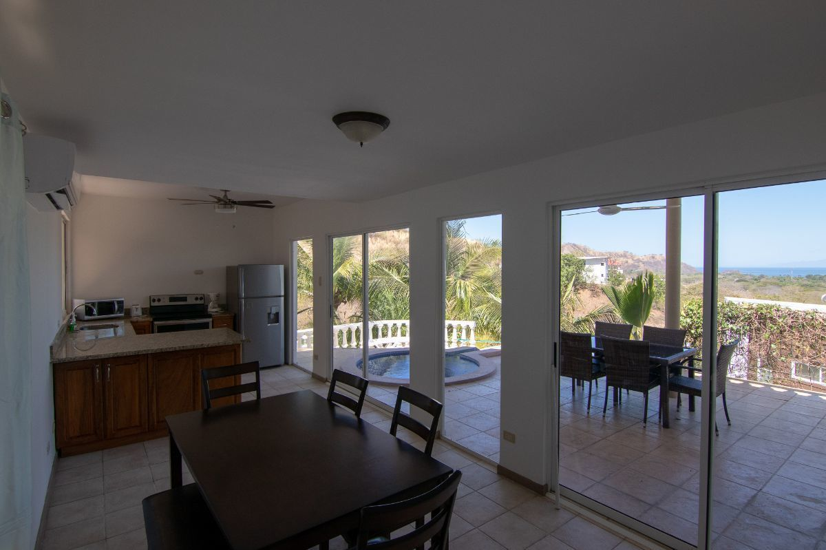 5 of 14: Spacious living room and kitchen
