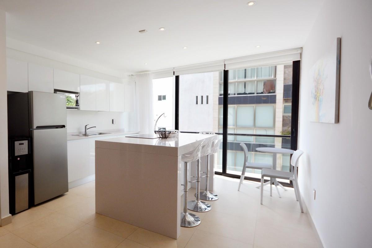 4 of 13: Apartamento con diseño moderno y distribución funcional.