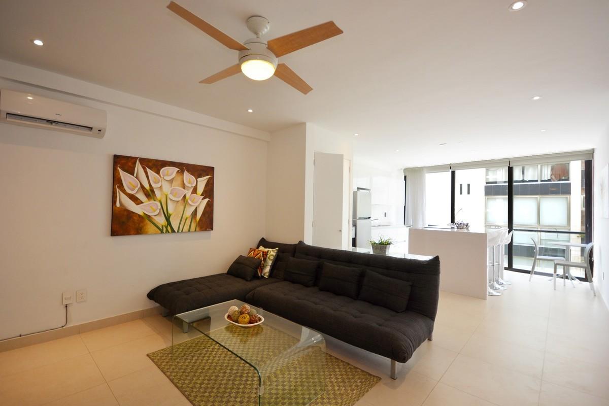 2 of 13: Apartamento con diseño moderno y distribución funcional.