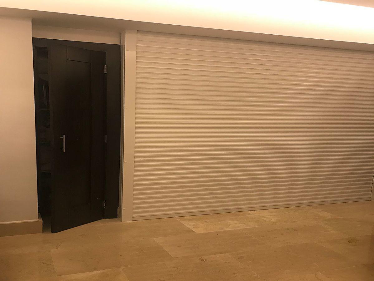 16 de 40: Área de habitaciones separada con shutter