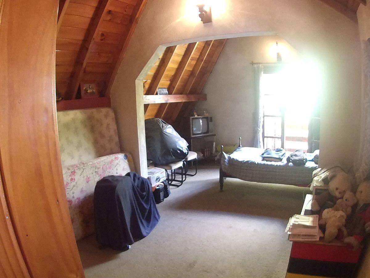 12 de 27: Dormitorio