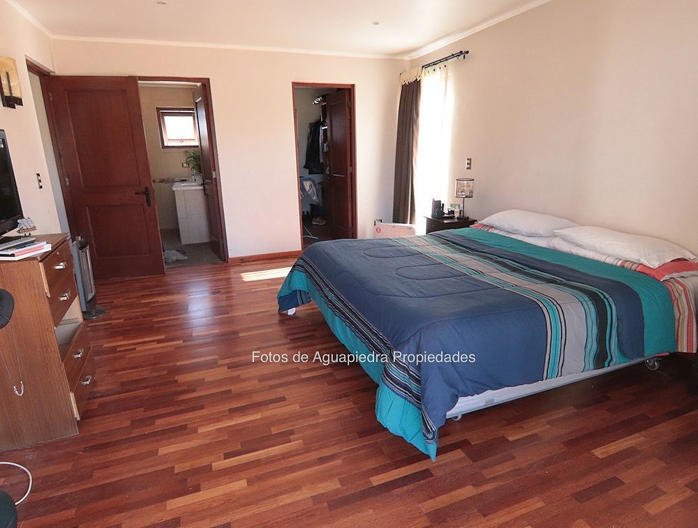 13 de 26: Dormitorio Principal en suite y walking closet