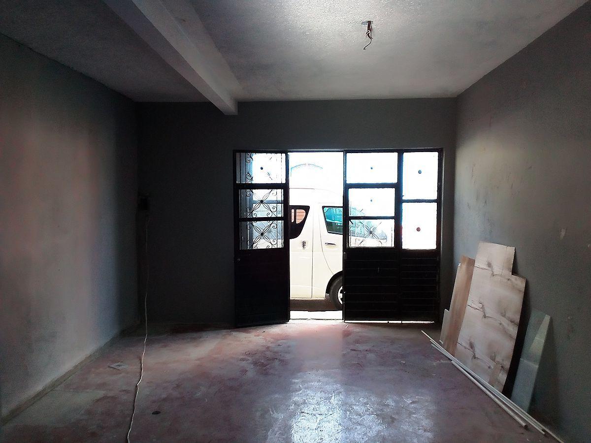 4 de 9: Espacio de Garage techado.