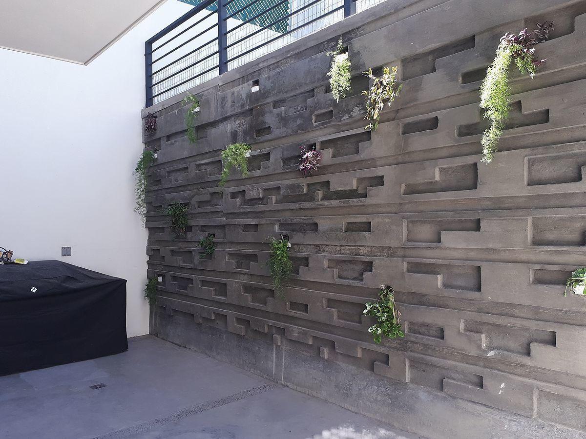 7 de 31: Muro de contencion patio trasero. Con moderno diseño.