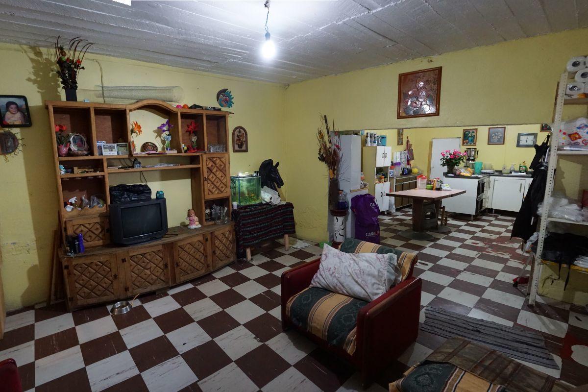 3 de 11: Sala y cocina planta baja.