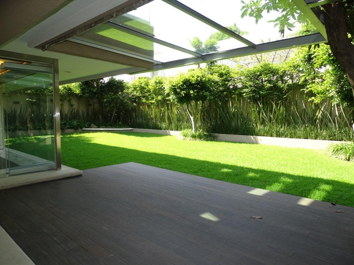 3 de 35: Terraza techada al jardín