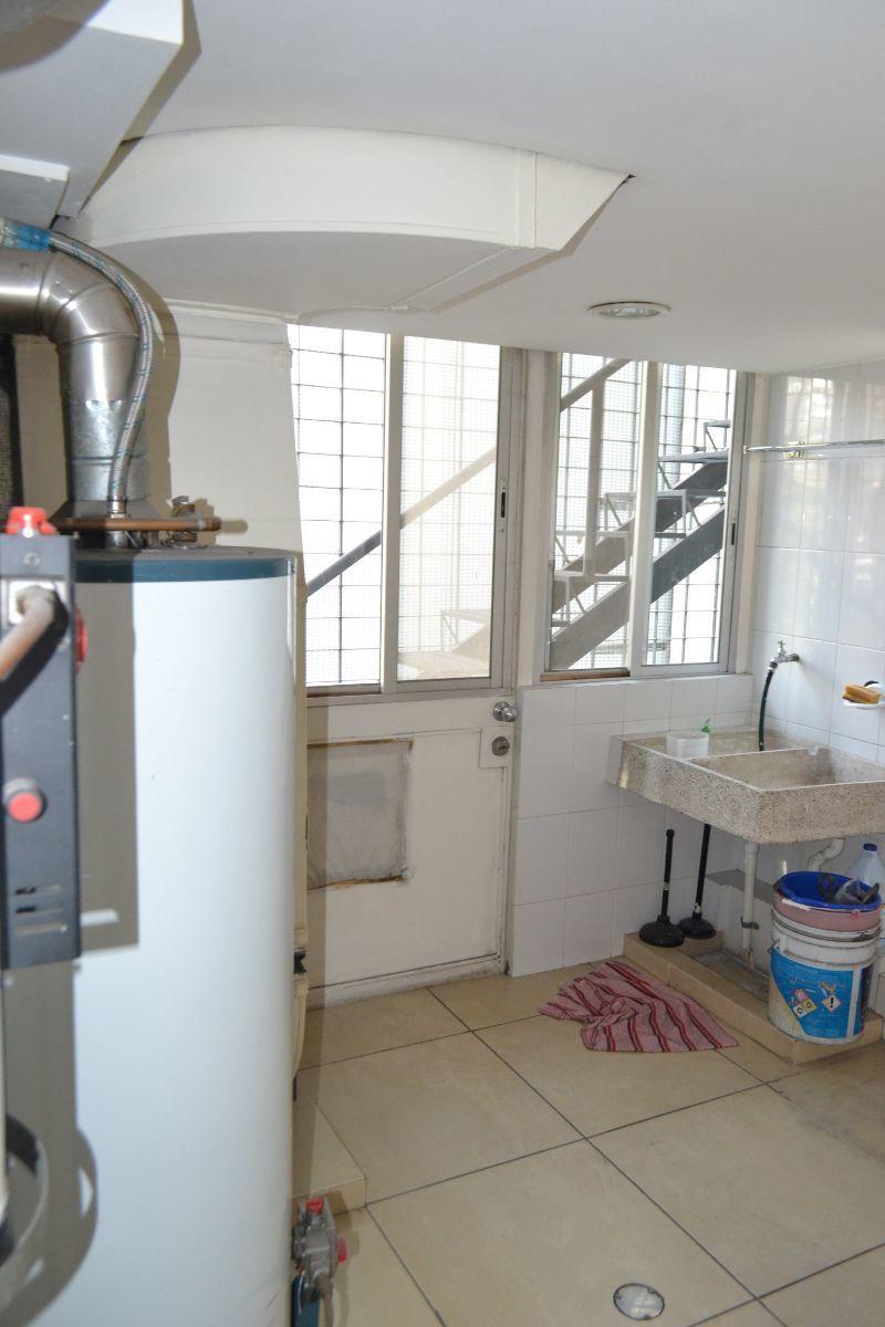 21 de 38: Área de lavandería