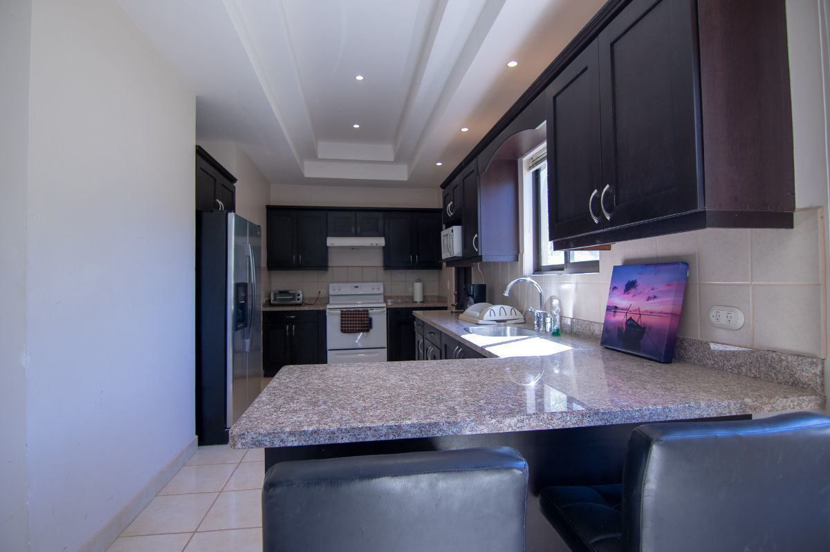 6 of 12: Kitchen with granite counter tops