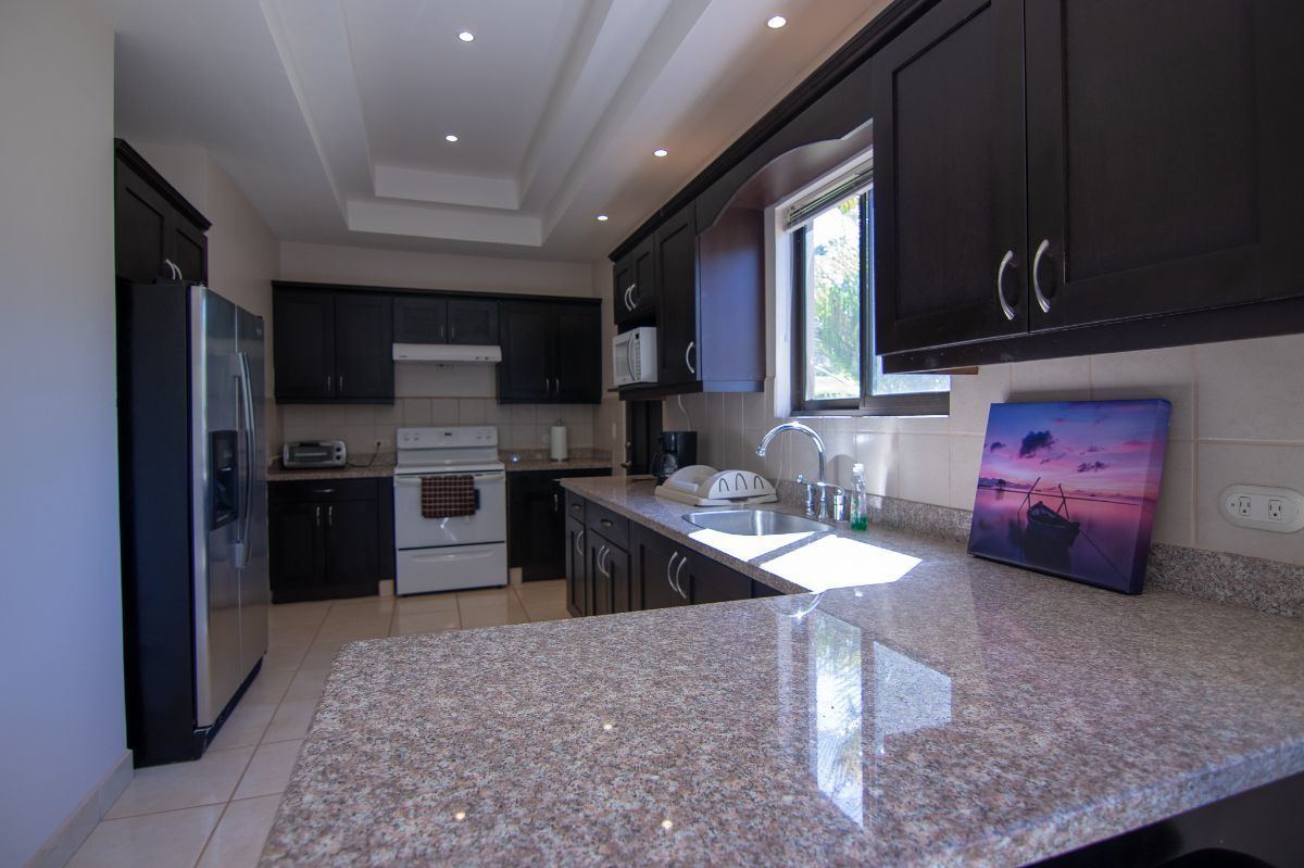 7 of 12: Kitchen with granite counter tops