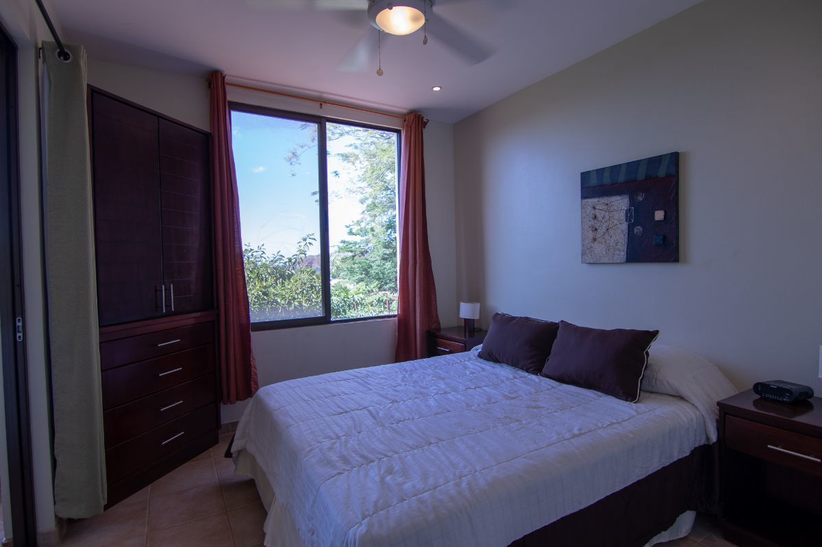7 of 14: Ocean view bedroom