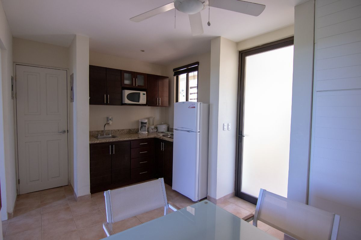 4 of 14: Living room with equipped kitchen