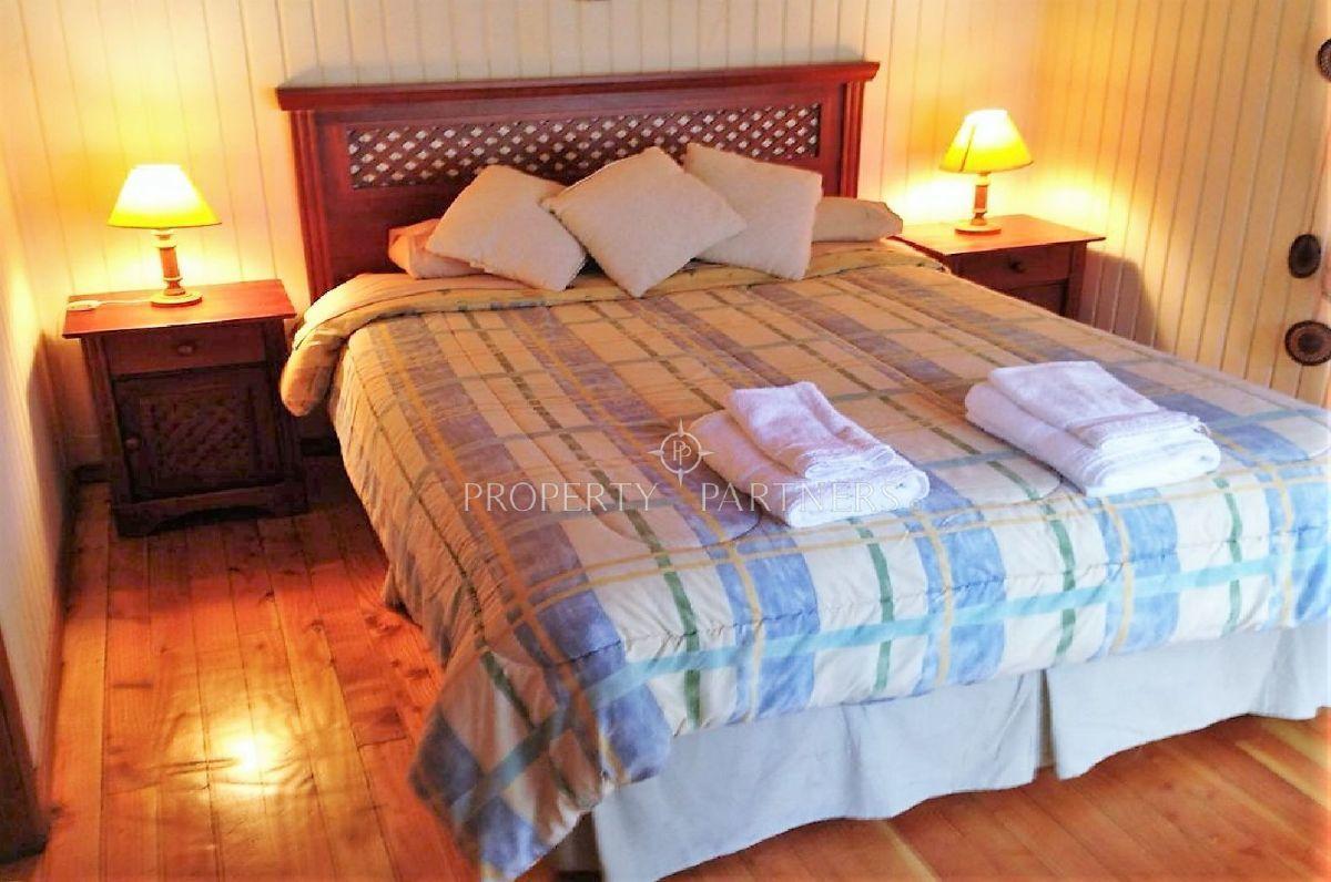 8 de 13: Dormitorio en suite