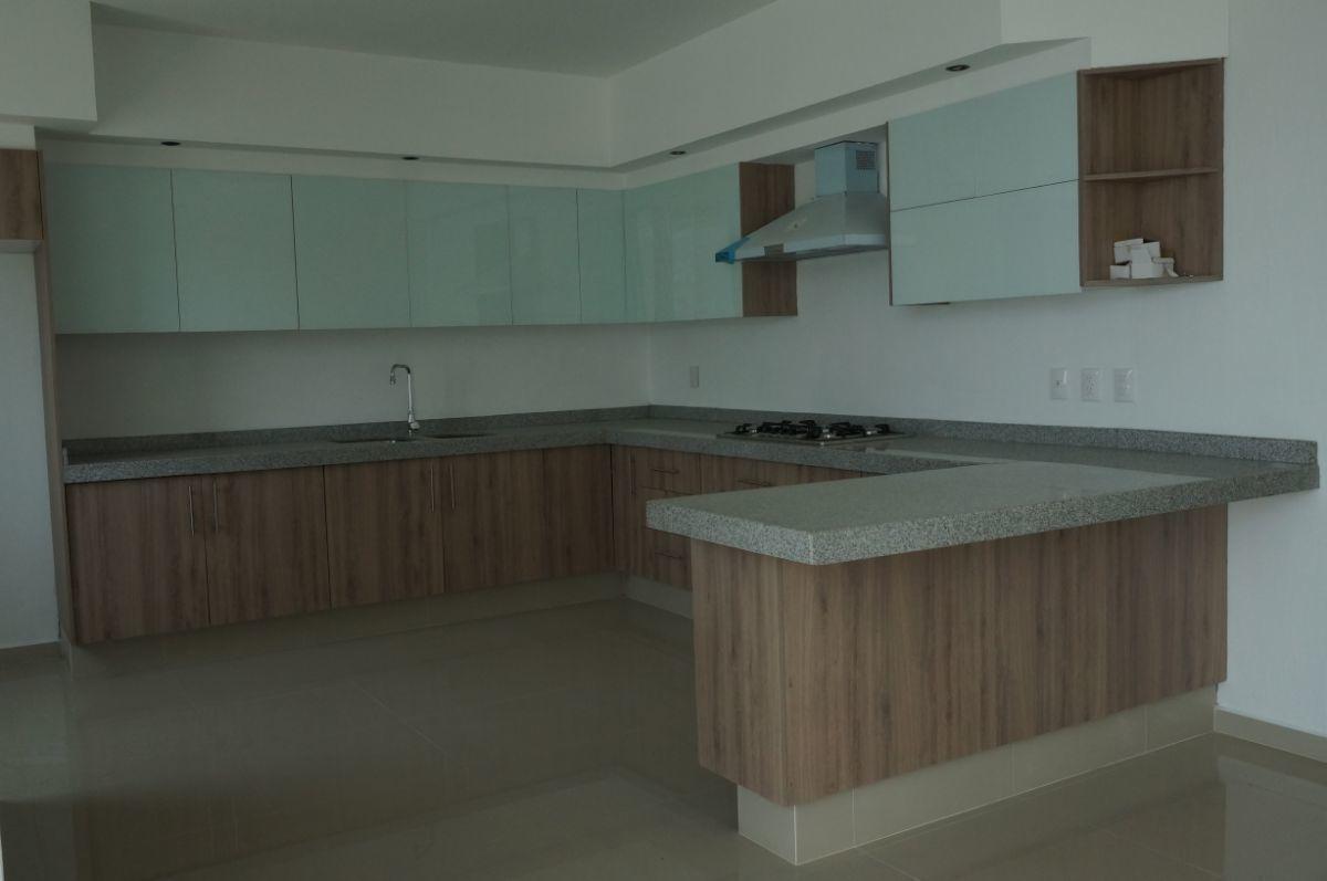5 de 33: El color de la cocina de esta casa es café