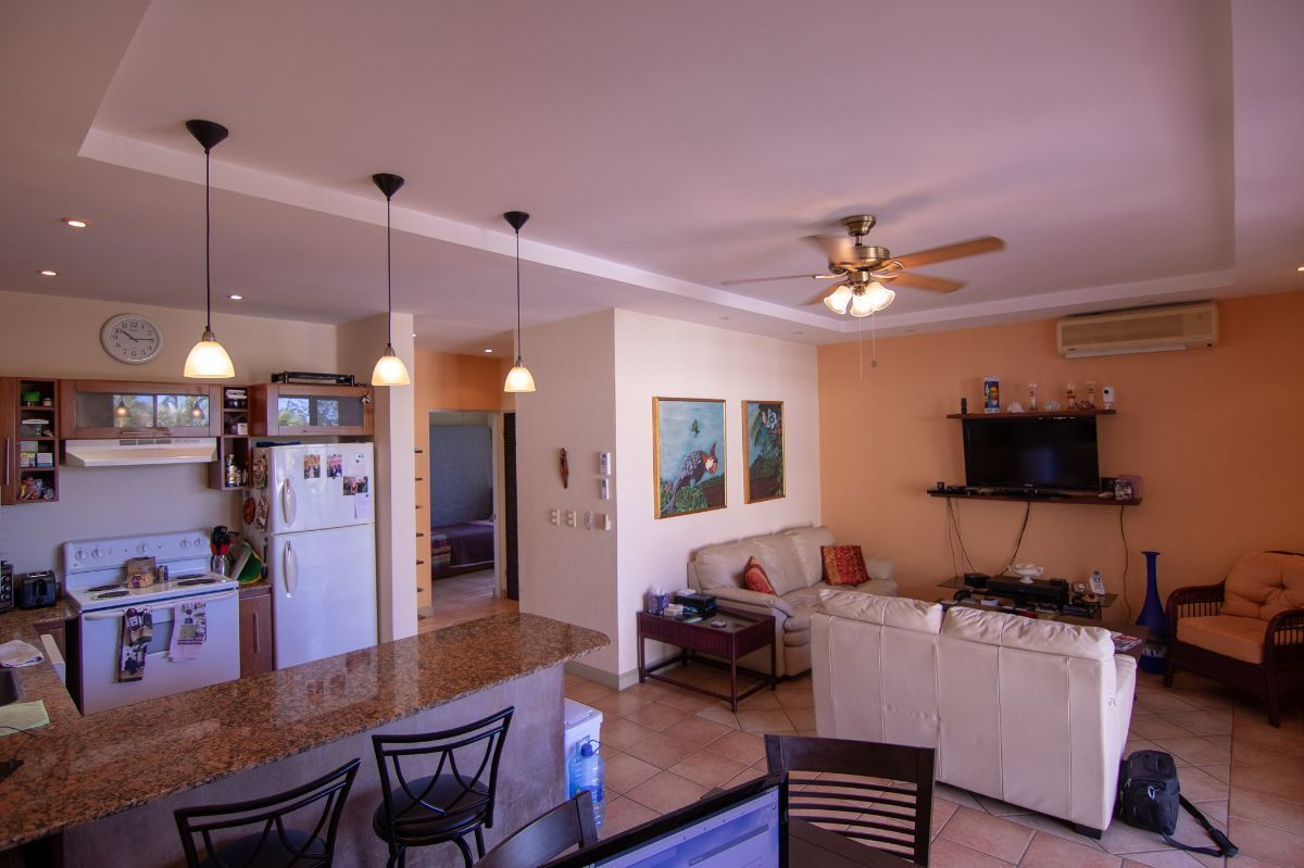 2 of 12: Spacious living room with kitchen
