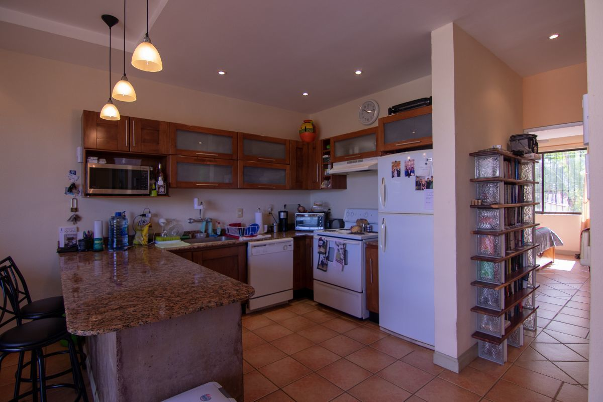 6 of 12: Kitchen with granite counter top