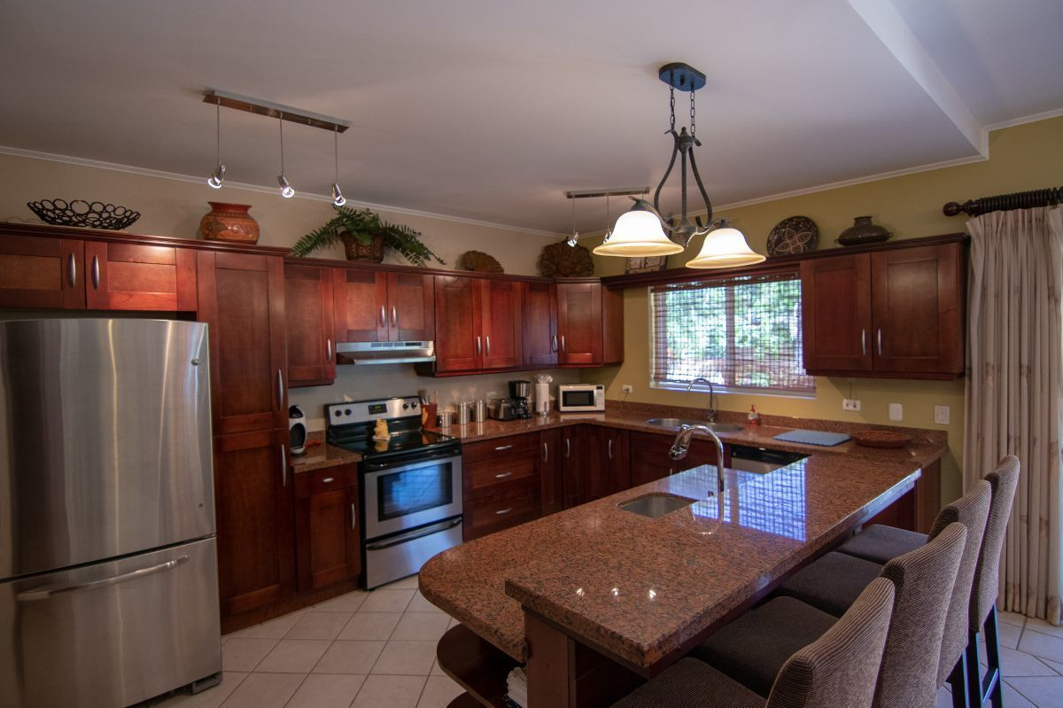 10 of 21: Large kitchen with granite counter top
