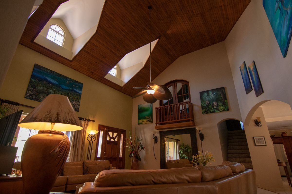 5 of 21: Spacious living room with vaulted ceilings