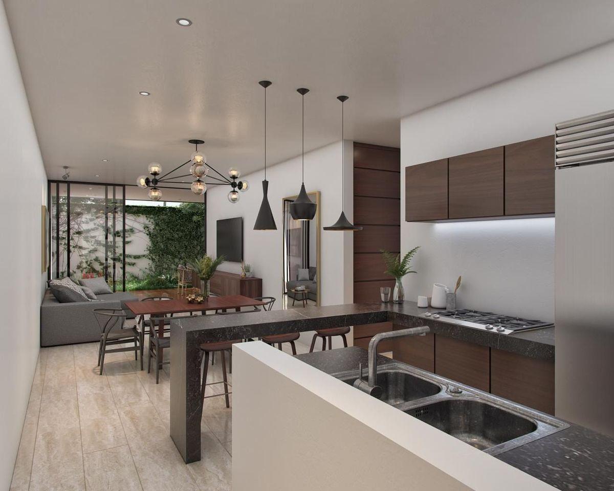 2 de 12: Cocinas equipadas con mesetas de granito y muebles.