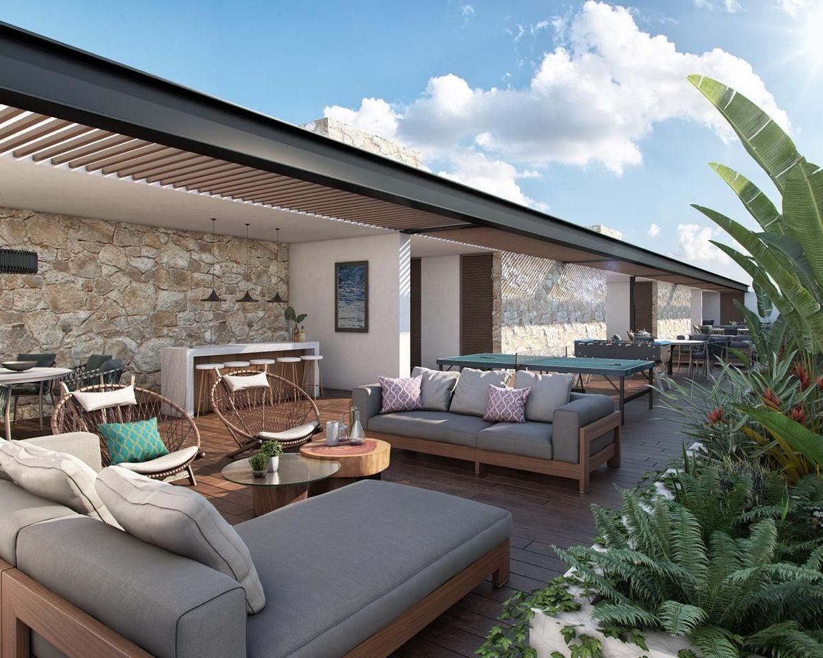 5 de 12: Area Lounge de Penthouse  parte techada y otra al aire libre