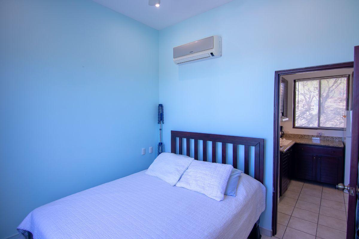 8 of 14: Ocean view bedroom