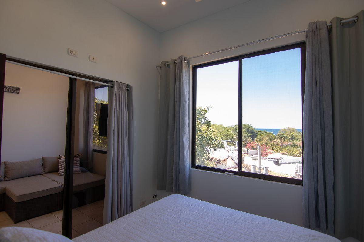 7 of 14: Ocean view bedroom