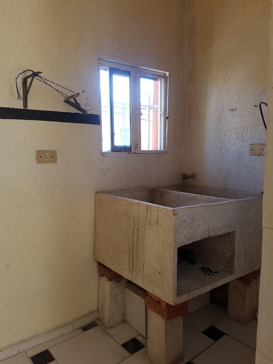 12 de 34: Cuarto de lavado casa planta alta
