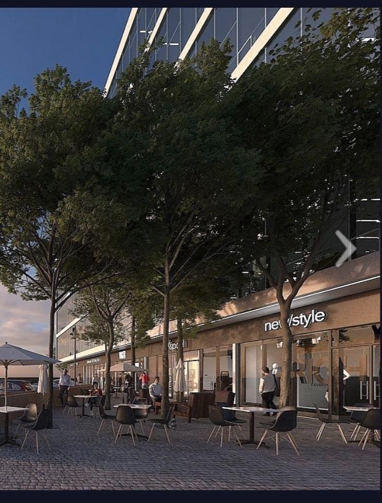 6 de 7: Plaza comercial en planta baja
