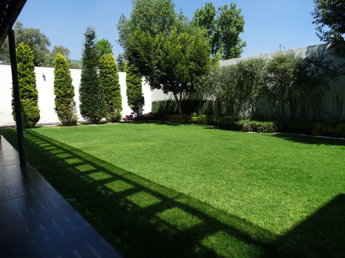 11 de 18: Terraza al jardín