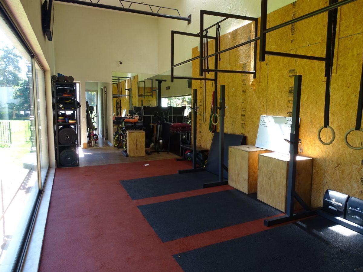 12 de 48: Gym con acceso al jardín
