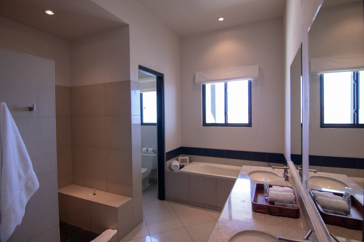 20 of 35: Master bathroom with bathtub and walk in shower