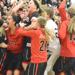 Shakopee players, coaches and fans erupt in elation at midcourt following miracle shot by Koenen